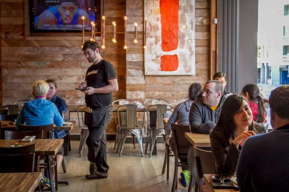 Diners enjoy dinner at Eureka in Berkeley. Photo: John Storey