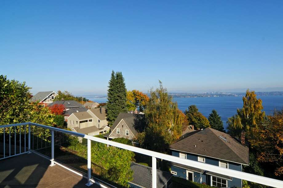 First up is 610 36th Ave. The 3,510-square-foot house, built in 1910, has four bedrooms, 1.75 bathrooms, exposed fir moldings and box beams, built-ins, French doors, a sun room, a front porch and views of Lake Washington and the Cascade Mountains on a 6,200-square-foot lot. It's listed for $950,000. Open houses are scheduled for 1 p.m. to 4 p.m. Saturday and Sunday. Photo: Stefan Enriquez, Courtesy Lawrence Crites, Lake & Co. Real Estate