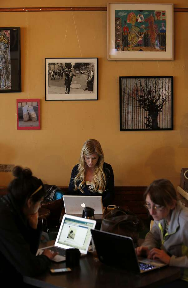 Patrons stare into their laptop screens at Cafe La Boheme near 24th and Mission streets, a once-bedraggled, increasingly upscale locale that's a techie favorite. Photo: Carlos Avila Gonzalez, The Chronicle