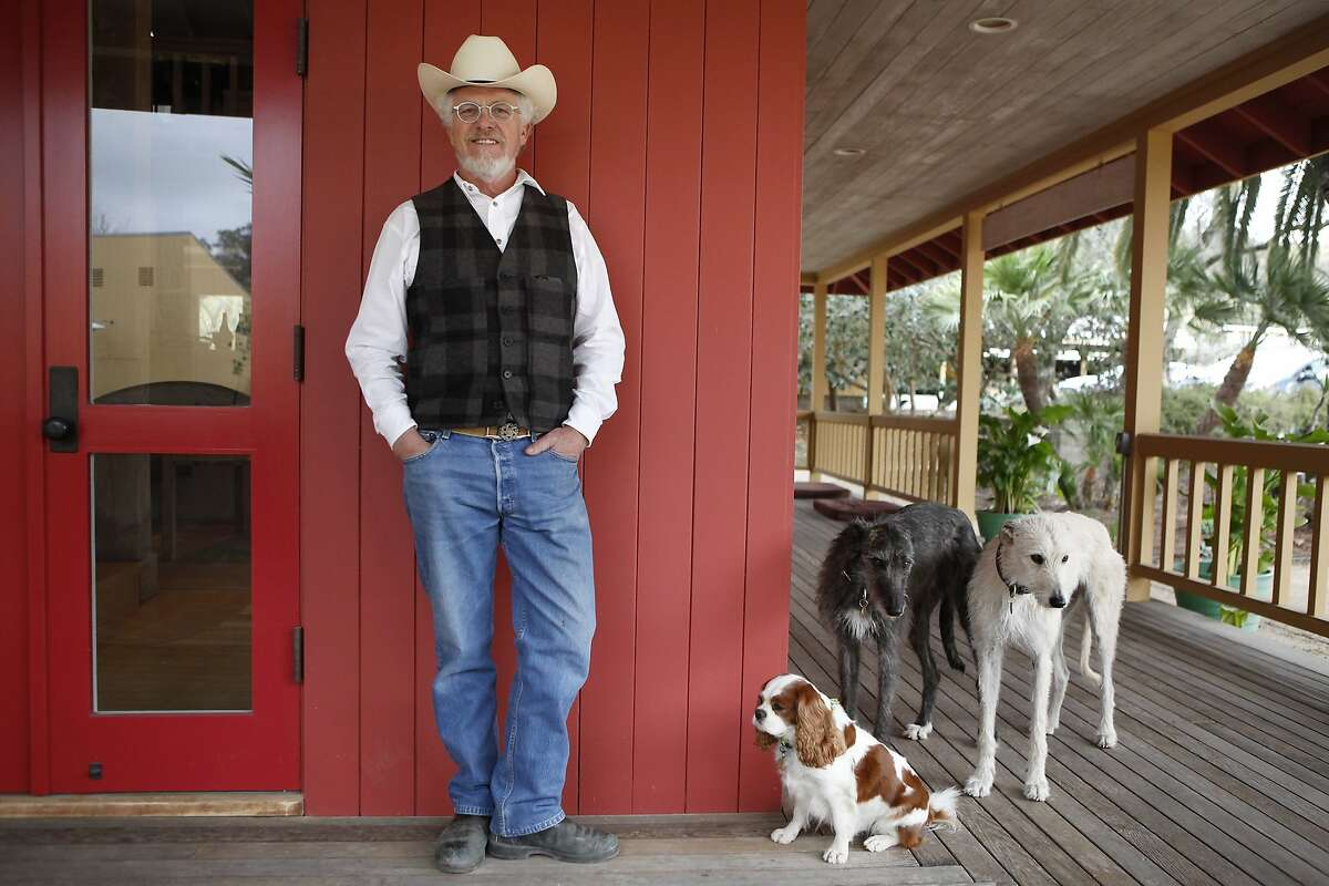 Lee Hudson poses for a portrait with his dogs outside his office at his Hudson Ranch property in Napa, CA, Wednesday, January 29, 2014.
