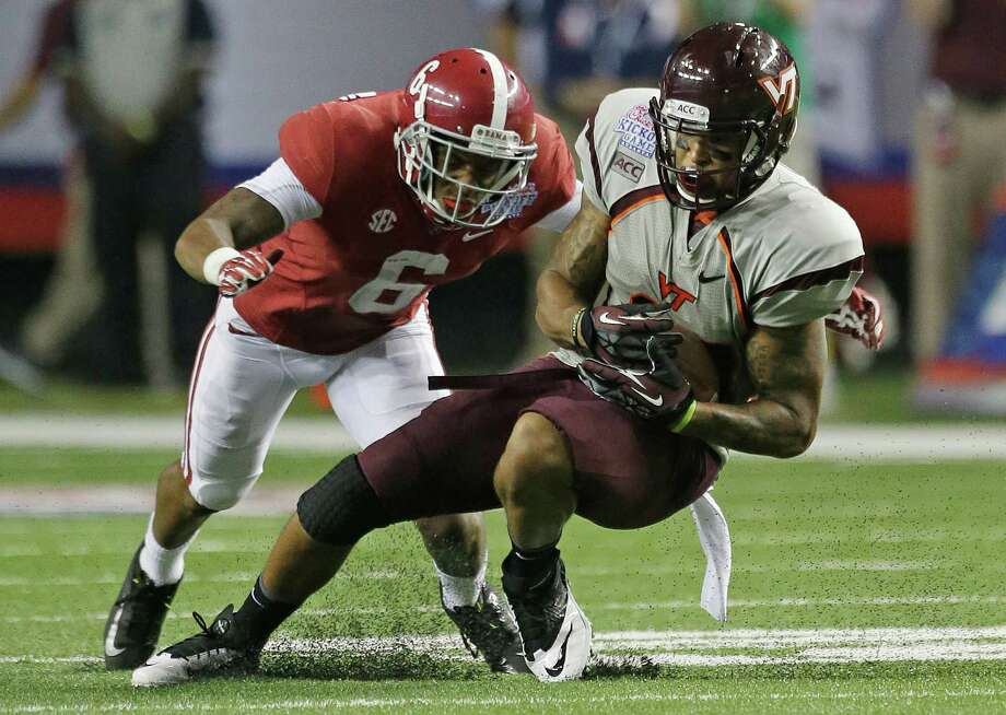 Virginia Tech running back Trey Edmunds (14) is stopped by Alabama defensive back Ha Ha Clinton-Dix (6) in the second half of an NCAA college football game in Atlanta Saturday, Aug. 31, 2013. Alabama beat Virginia Tech 35-10. (AP Photo/Dave Martin) Photo: Dave Martin, Associated Press / AP