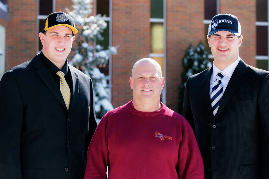Varsity Football Coach, Joe Dellavecchia, with Peter Mestre and Steve Hashemi.  Mestre is heading off to Bryant while Hashemi is staying in Connecticut and going to UConn.  Mestre and Hashemi are both from Shelton. Photo: Andrew Merrill