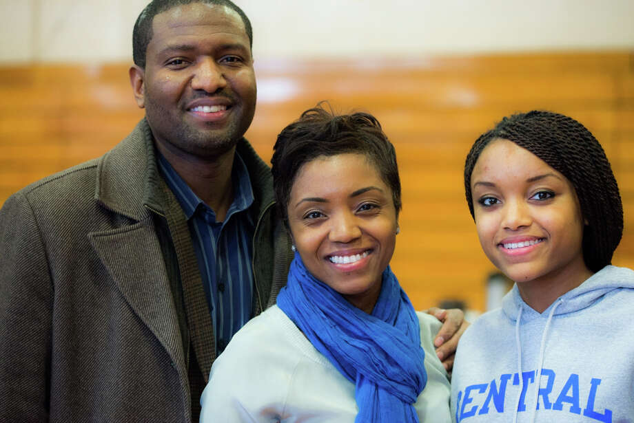 Scales with her mother and father. Photo: Andrew Merrill