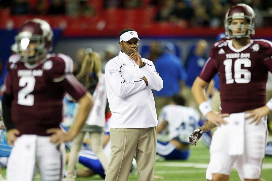 Texas A&M head coach Kevin Sumlin watches his team warm up before the Chick-fil-A Bowl against Duke at the Georgia Dome on, Tuesday, Dec. 31, 2013, in Atlanta. Photo: Brett Coomer, Houston Chronicle / © 2013  Houston Chronicle