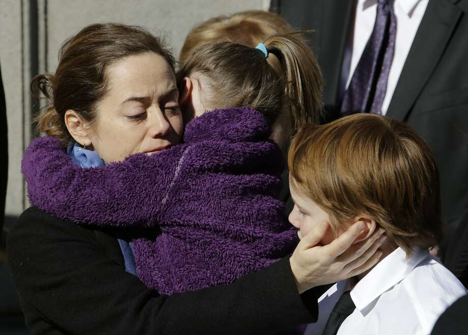 Mimi O'Donnell, estranged partner of actor Philip Seymour Hoffman, comforts two of their children, daughter Willa, and son Cooper as his casket arrives at the Church of St. Ignatius Loyola, Friday, Feb. 7, 2014 in New York. Hoffman, 46, was found dead Sunday of an apparent heroin overdose. (AP Photo/Mark Lennihan) Photo: Mark Lennihan, Associated Press