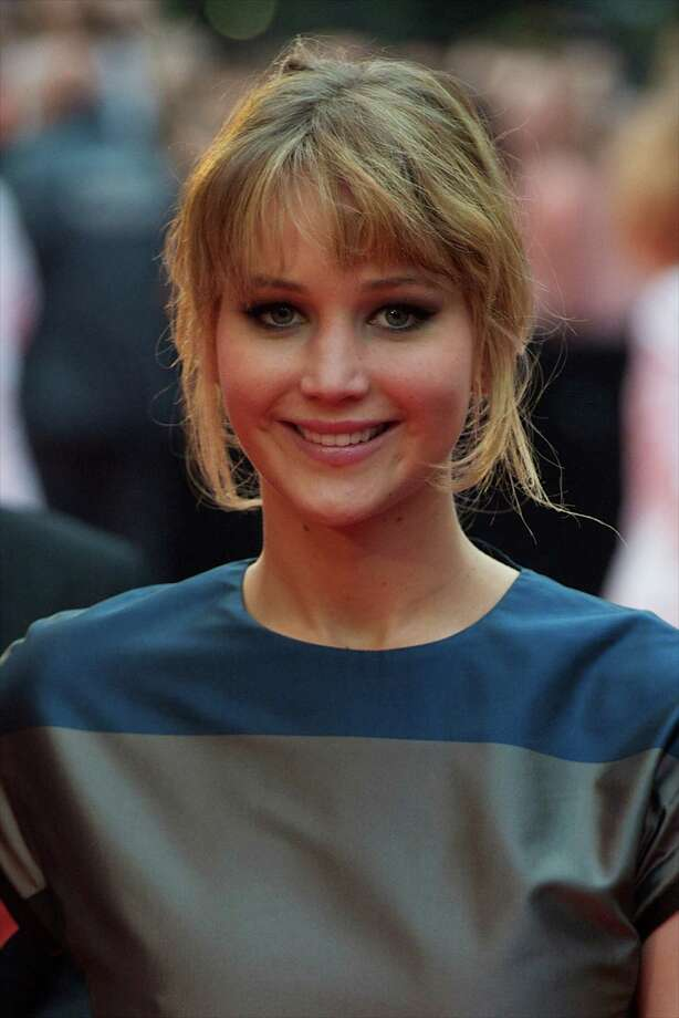"""""""The Hunger Games"""" actress Jennifer Lawrence came to the aid of a distressed young woman lying on the grass outside of her apartment, waiting beside her until paramedics arrived. Photo: Carlos Alvarez, Getty Images / 2012 Getty Images"""