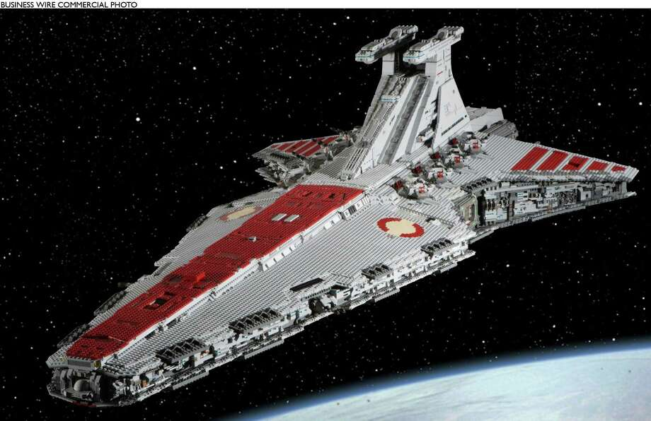 This one-of-a-kind 8-foot LEGO model of a Star Wars Rebel Attack Cruiser, certified authentic by signature of filmmaker George Lucas himself, is now available at auction on eBay. One hundred percent of the proceeds from the sale of the model will benefit Habitat for Humanity's Hurricane Relief Efforts.  / LEGO SYSTEMS