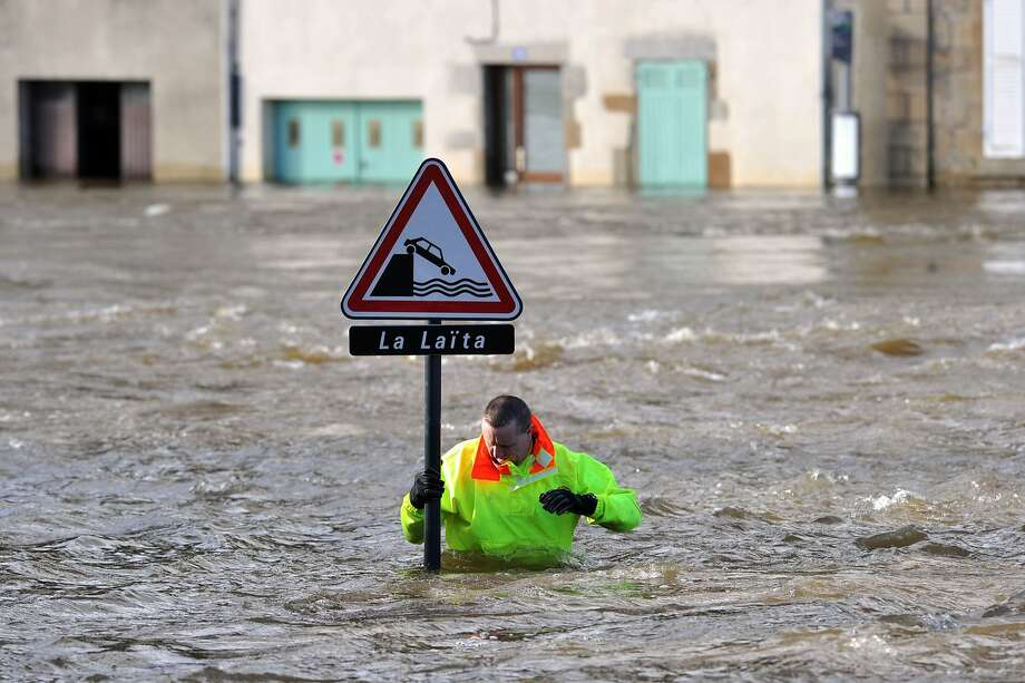 After all, you don't want your car to get wet: In Quimperle, France, a sign warns passing motorists to be careful not to drive off the bank and into the Laita River. Photo: Frank Perry, AFP/Getty Images