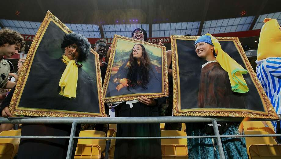 Masterpiece theater:In Wellington, New Zealand, the Mona Lisa and a couple of friends cheer on the national rugby sevens team. Photo: Marty Melville, AFP/Getty Images