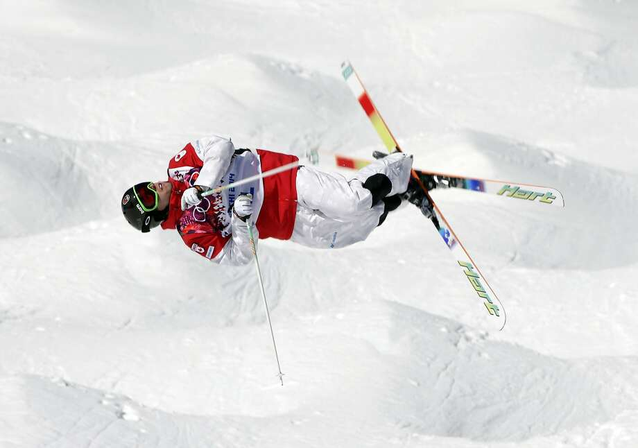Mogul meister:Canada's Alex Bilodeau goes horizontal while barreling through the bumps at Rosa Khutor Extreme Park in Krasnaya Polyana, Russia. Photo: Andy Wong, Associated Press