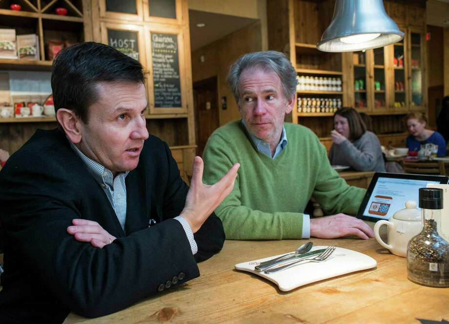 "Left to right; Charles Moore, advisor, SolarCoin, and John Dolan, chairman, SolarCoin, discuss their new business at ""Le Pain Quotidien"" on Greenwich Avenue, Greenwich, CT on Friday, February, 7th, 2014. Photo: Mark Conrad / Connecticut Post Freelance"