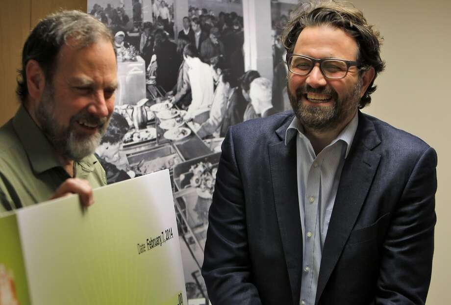 Barry Stenger, executive director of the St. Anthony Foundation, accepts a six-figure donation to the organization's medical clinic from Mikkel Svane, CEO of Mid-Market neighbor Zendesk. Photo: Carlos Avila Gonzalez, The Chronicle