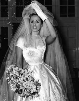 Love is in the air this week. What if you find yourself in need of a white dress? British actress Jackie Collins on her wedding day in 1950. Photo: Keystone, Getty Images