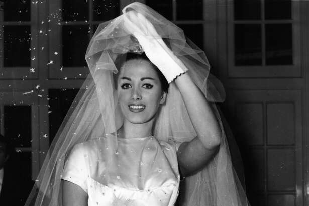 British actress Jackie Collins on her wedding day in 1950.