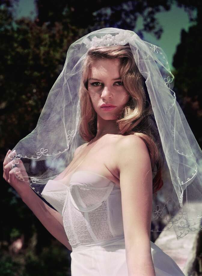 French actress Brigitte Bardot, nicknamed the Sex Kitten, wearing a wedding veil in 1956. Photo: John Chillingworth, Getty Images