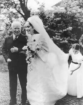 Comic actor Charlie Chaplin (1889 - 1977) with his daughter Josephine during her wedding to Greek businessman Nikki Sistovaris in 1969. On the right is Josephine's sister and bridesmaid Annette. Photo: Express, Getty Images