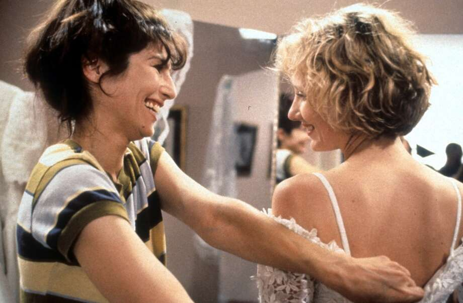 "Catherine Keener helps Anne Heche into a wedding dress in a scene from the film ""Walking And Talking,"" 1996. Photo: Archive Photos, Getty Images"