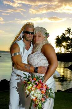 "Duane ""Dog"" Chapman and Beth (Smith) Chapman pose at sunset after their lavish wedding ceremony at the Hilton Waikoloa Village in Waikoloa, on the Big Island of Hawaii, May 20, 2006. About 250 people attended the wedding. Chapman's daughter was killed the night before the ceremony Photo: Lucy Pemoni, FilmMagic"