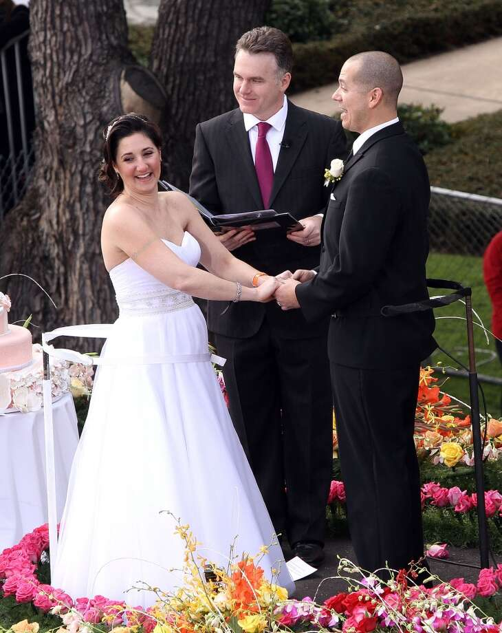 "Bride Nicole Angellilo, officiant DJ Valentine and groom Gerald Sapienza during their Live Wedding Atop ""The Love Float"" at the 124th Tournament of Roses Parade on January 1, 2013 in Pasadena, California. Photo: Maury Phillips, WireImage"