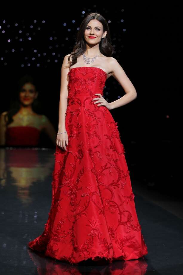 Actress Victoria Justice wears Oscar de la Renta as she participates in the Go Red For Women-The Heart Truth Red Dress Collection show during Fashion Week in New York. (AP Photo/Starpix, Amanda Schwab) Photo: Amanda Schwab, Associated Press