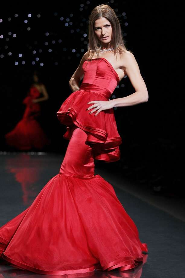 Actress Jill Hennessy wears Dennis Basso as she participates in the Go Red For Women-The Heart Truth Red Dress Collection show during Fashion Week in New York. (AP Photo/Starpix, Amanda Schwab) Photo: Amanda Schwab, Associated Press