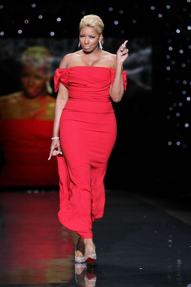 TV personality NeNe Leakes wears Black Halo as she participates in the Go Red For Women-The Heart Truth Red Dress Collection show during Fashion Week in New York. (AP Photo/Starpix, Amanda Schwab) Photo: Amanda Schwab, Associated Press