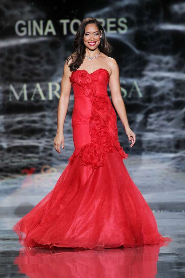 Gina Torres wears Marchesa as she participates in the Go Red For Women-The Heart Truth Red Dress Collection show during Fashion Week in New York. (AP Photo/Starpix, Amanda Schwab) Photo: Amanda Schwab, Associated Press