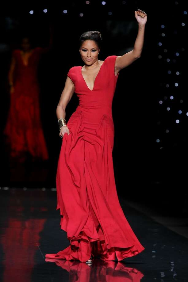 TV personality Alicia Quarles wears Zac Posen as she participates in the Go Red For Women-The Heart Truth Red Dress Collection show during Fashion Week in New York. (AP Photo/Starpix, Amanda Schwab) Photo: Amanda Schwab, Associated Press