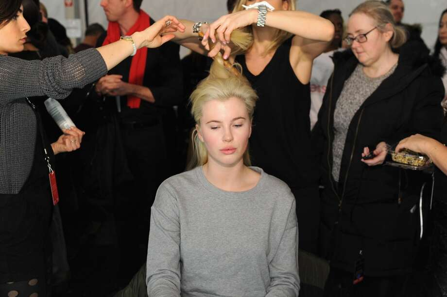 Ireland Baldwin prepares backstage at Go Red For Women The Heart Truth Red Dress Collection 2014 Show Made Possible By Macy's And SUBWAY Restaurants at The Theatre at Lincoln Center on February 6, 2014 in New York City.  (Photo by Dimitrios Kambouris/Getty Images) Photo: Dimitrios Kambouris, Getty Images