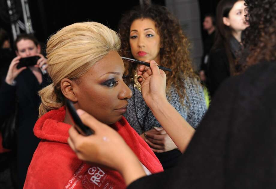 Actress NeNe Leakes prepares backstage at Go Red For Women The Heart Truth Red Dress Collection 2014 Show Made Possible By Macy's And SUBWAY Restaurants at The Theatre at Lincoln Center on February 6, 2014 in New York City.  (Photo by Dimitrios Kambouris/Getty Images) Photo: Dimitrios Kambouris, Getty Images
