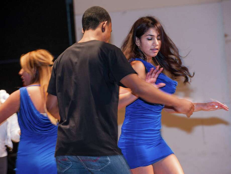 Aris Villadiego and Milevie Ruiz of the Greenwich high school Salsa club perform in the high school auditorium in one of the events at the school to showcase the diverse student body there. Greenwich, CT, Friday, February, 7th, 2014. Photo: Mark Conrad / Connecticut Post Freelance