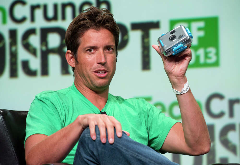 Nick Woodman, the founder and CEO of GoPro, holds up an original model of a GoPro camera in 2013. His company is seeking more money from investors. Photo: David Paul Morris / Bloomberg / ONLINE_YES