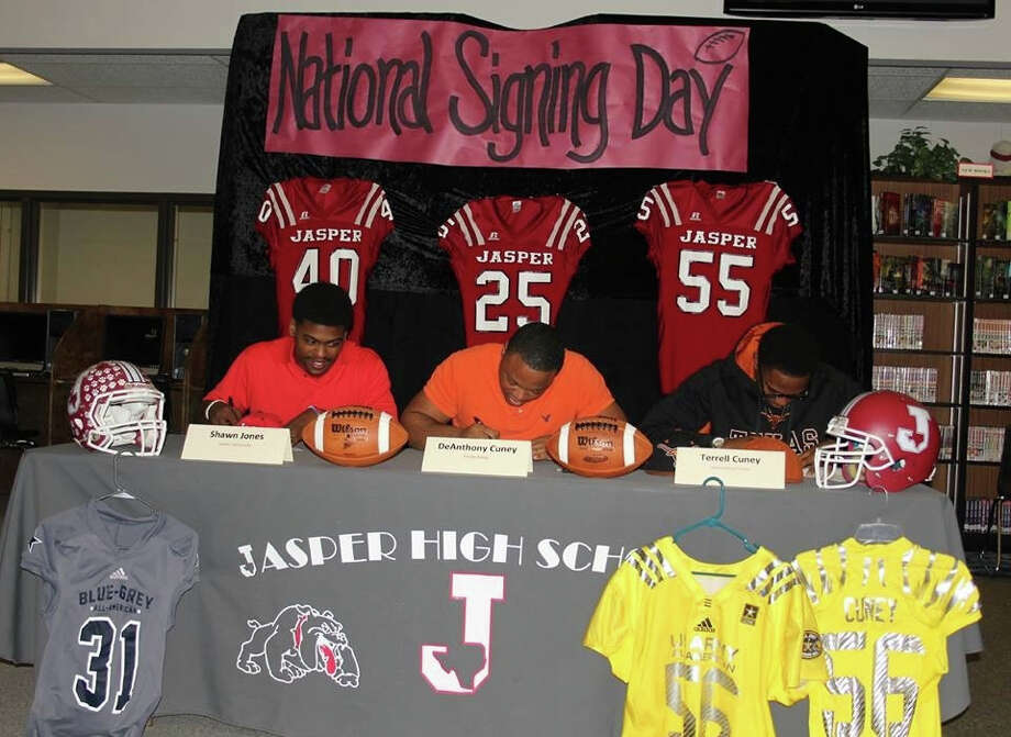 Shawn Jones, DeAnthony Cuney and Terell Cuney signing letters of intent. Photo by Shannon Stott