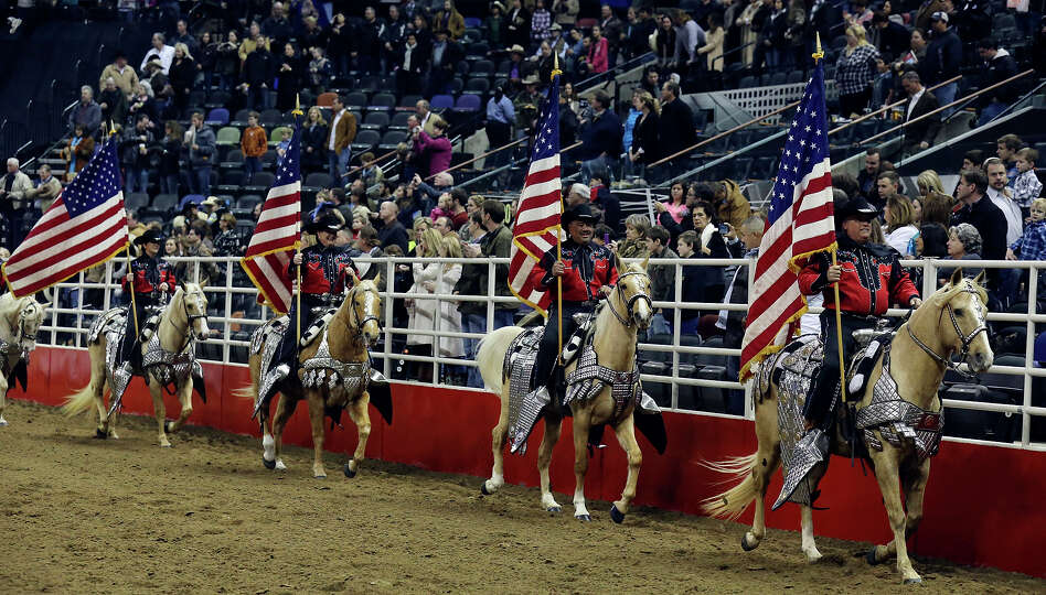 Riders in the Jack Sellers Bexar County Palomino Patrol, Inc. take part in the grand entry during th