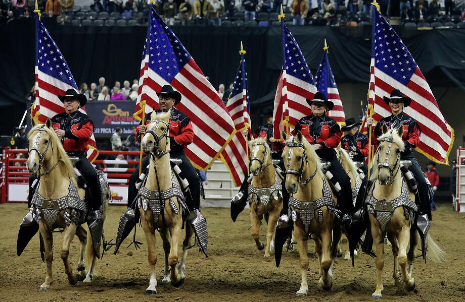 Riders in the Jack Sellers Bexar County Palomino Patrol, Inc. take part in the grand entry during the San Antonio Stock Show & Rodeo Thursday Feb. 6, 2014 at the AT&T Center. Photo: Edward A. Ornelas, San Antonio Express-News / © 2014 San Antonio Express-News