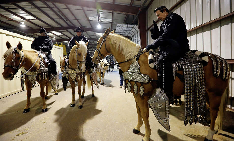 Jack Sellers Bexar County Palomino Patrol, Inc. rider Bucky Ball (right) leads a prayer before the group takes part in the grand entry during the San Antonio Stock Show & Rodeo Thursday Feb. 6, 2014 at the AT&T Center. Photo: Edward A. Ornelas, San Antonio Express-News / © 2014 San Antonio Express-News