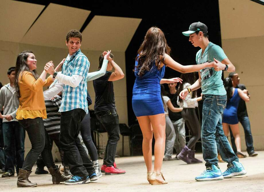 The Greenwich high school Salsa club performs in the high school auditorium as one of the events to showcase the diverse student body at the high school. Greenwich, CT, Friday, February, 7th, 2014. Photo: Mark Conrad / Connecticut Post Freelance