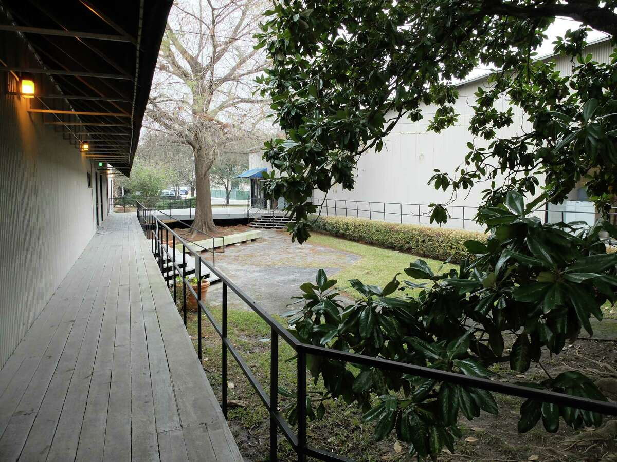 Martel Center, left, and the Rice Media Center were built as temporary structures more than 40 years ago. They share a courtyard and are connected by a wooden deck.