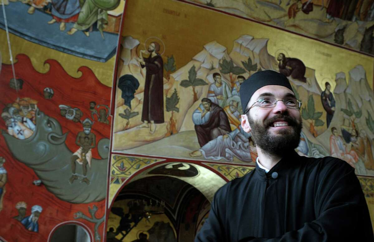 Orthodox priest Branko Vujacic says the Serbian Orthodox Church of Christ's Resurrection has seen an increase in visitors since the fresco was completed.