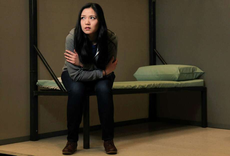 """Lei Xu, sings role of 'Diane', rehearses a jail scene in the opera  """"Bound"""", it's the story of a Vietnamese-American high school student struggling to reconcile her family's past and present, will be performed three times this week. ( Mayra Beltran / Houston Chronicle ) Photo: Mayra Beltran, Staff / © 2013 Houston Chronicle"""