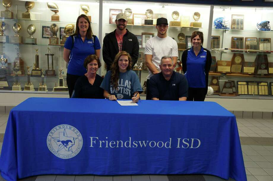 Sidnee Fitzpatrick is joined by her parents Tony and Sherri Fitzpatrick, brothers Austin and Will and coaches Kelly Beck and Shayna Sheppard as she signs to play for Dallas Baptist University. Photo: Provided By Friendswood High School