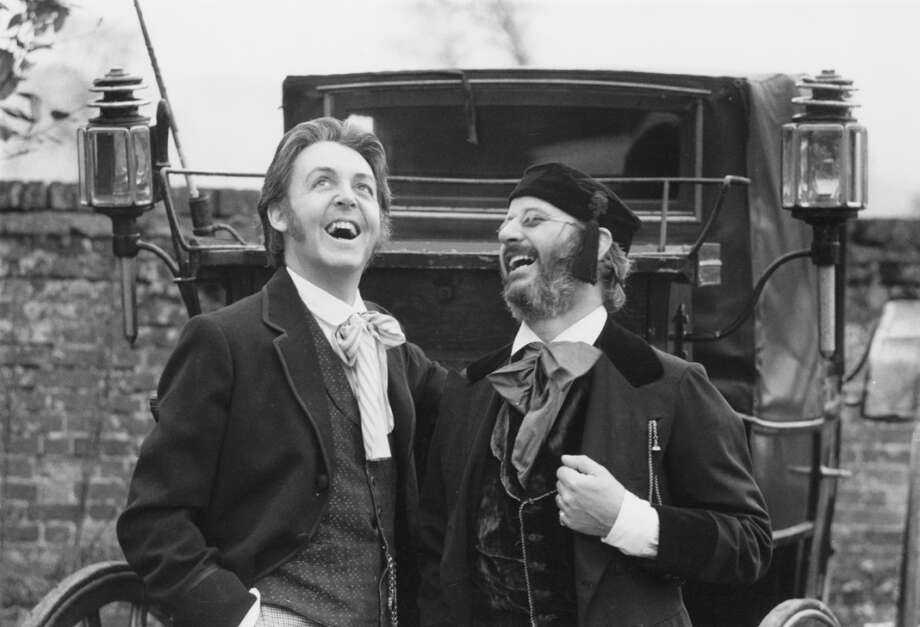 English singer, songwriter and musician Paul McCartney with drummer Ringo Starr in period costume for a scene in the film 'Give My Regards to Broad Street', 1984. He also wrote the screenplay for the film. (Photo by Richard Blanshard/Getty Images) Photo: Richard Blanshard, Getty Images