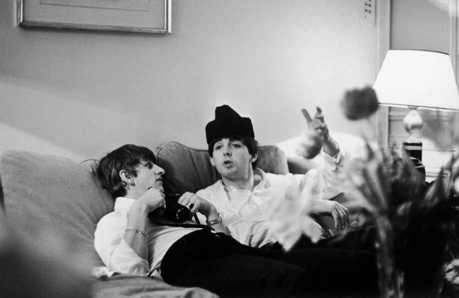 Ringo Starr and Paul McCartney of British pop group The Beatles relax in a Paris hotel room Jan. 16, 1964.  (Photo by Harry Benson/Express/Getty Images) Photo: Harry Benson, Getty Images