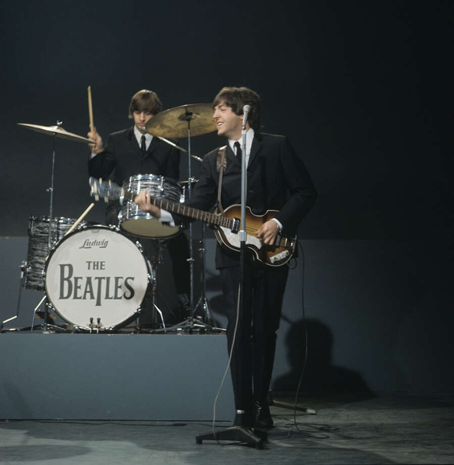 Drummer Ringo Starr, playing a Ludwig drum kit and Paul McCartney, playing a Hofner 500/1 'violin' bass guitar, of The Beatles perform on 'Shindig!' television show filmed at the Granville Studios in London, England on October 3, 1964. (Photo by David Redfern/Redferns) Photo: David Redfern, Redferns / 1964 David Redfern
