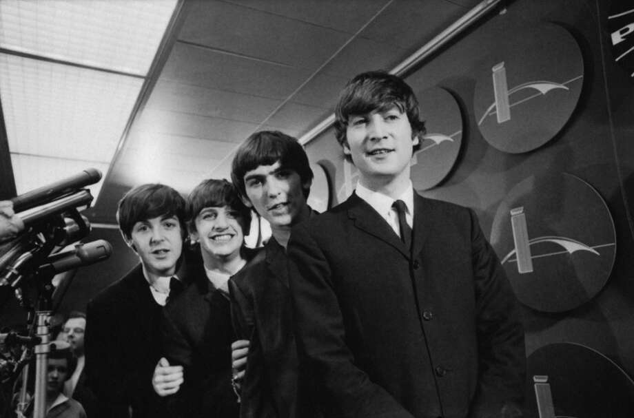 The Beatles after arriving at John F. Kennedy International Airport, February 7, 1964. From left: Paul McCartney, Ringo Starr, George Harrison and John Lennon. (Photo by CBS via Getty Images) Photo: CBS Photo Archive, CBS Via Getty Images