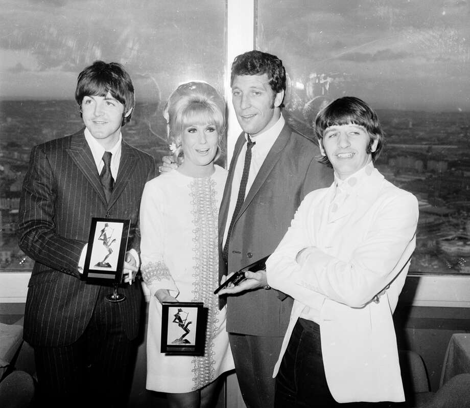 Paul McCartney, Dusty Springfield (1939 - 1999), Tom Jones and Ringo Starr with their awards at the Melody Maker Pop Poll luncheon in the GPO Tower restaurant, Sept. 13, 1966.  (Photo by Terry Disney/Express/Getty Images) Photo: Terry Disney, Getty Images / Hulton Archive