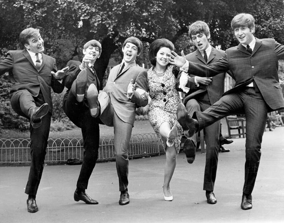 High kicking winners of the Melody Maker poll awards for 1963, from left; Billy J Kramer, who won the 'Best Hope For 1963' award, The Beatles, who won 'Top Vocal Group' and, between Beatles Paul and George, Susan Maughan, who won the award for 'Top Female Singer'.  (Photo by Keystone/Getty Images) Photo: Keystone, Getty Images / Hulton Archive