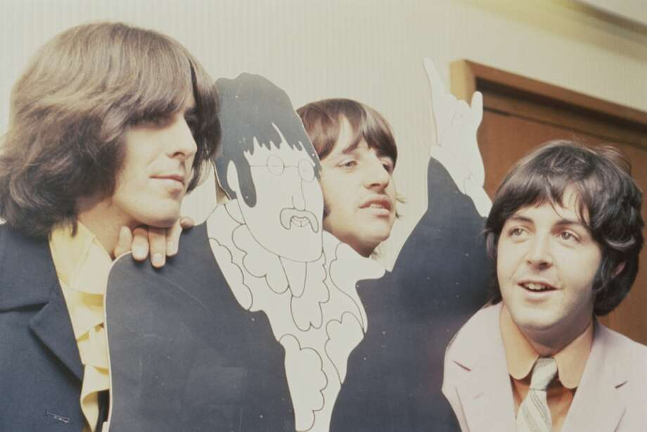 George Harrison (1943-2001), Ringo Starr and Paul McCartney from The Beatles attend a press screening for the film 'Yellow Submarine' along with a cut out of an animated John Lennon at the Bowater House Cinema in Knightsbridge, London on July 8, 1968. (Photo by Mark and Colleen Hayward/Redferns) Photo: Mark And Colleen Hayward, Redferns
