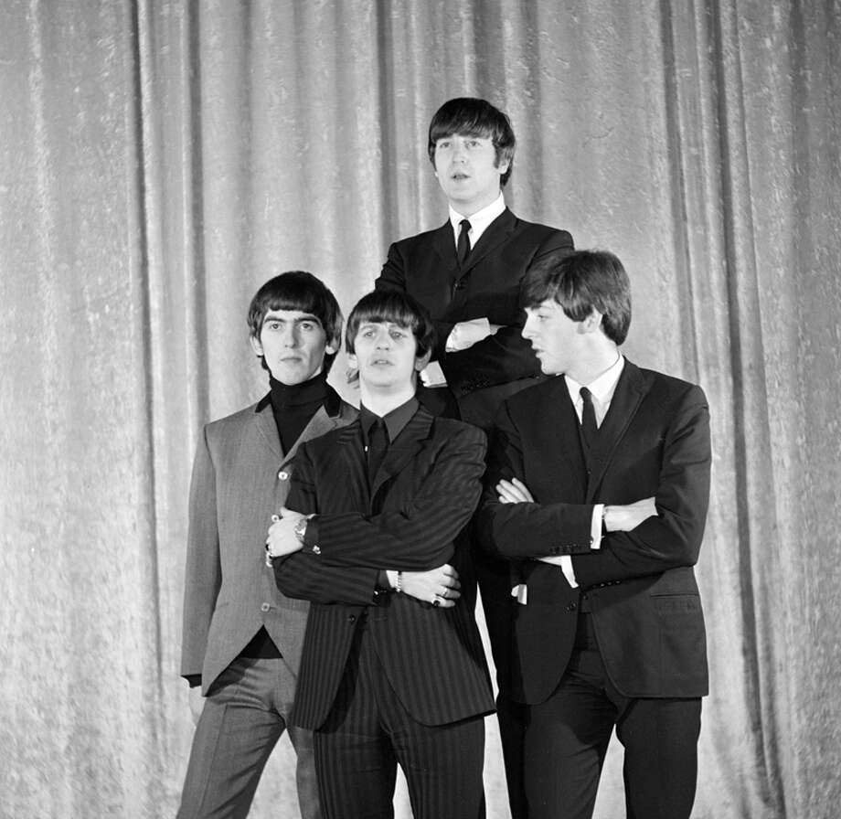 The Beatles at a photo shoot the day before their first appearance on THE ED SULLIVAN SHOW. From left: George Harrison, Ringo Starr, John Lennon, Paul McCartney. Image dated February 8, 1964. (Photo by CBS via Getty Images) Photo: CBS Photo Archive, CBS Via Getty Images / 1964 CBS Photo Archive