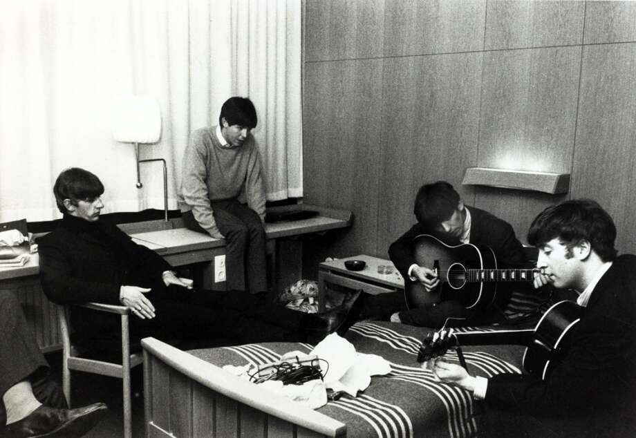 Pop Music Pesonalities, The Beatles, October 1963, Stockholm, The Beatles, l-r, Ringo Starr, Paul McCartney, George Harrison and John Lennon relaxing and trying some new songs in their hotel suite during their 8 day visit to Sweden  (Photo by Popperfoto/Getty Images) Photo: Popperfoto, Popperfoto/Getty Images